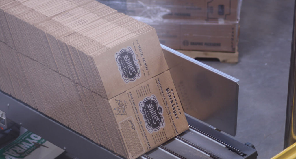Beer-Chronicle-Houston-Craft-Beer-Review-Featured-Shiner-Brewery-4-boxes-of-bohemian-black-lager-waiting-to-be-filled