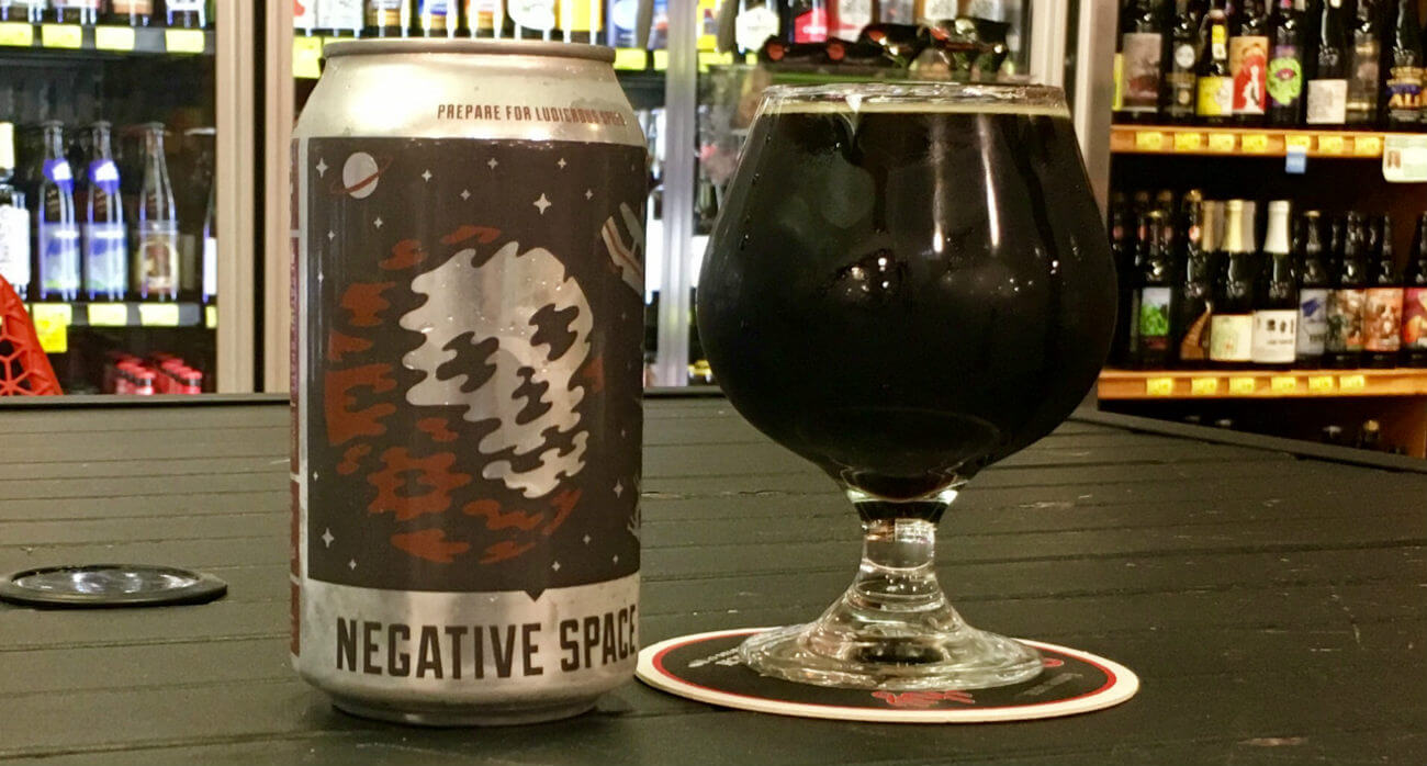 beer-chronicle-houston-craft-beer-review-11-below-negative-space-can-next-to-full-snifter-glass