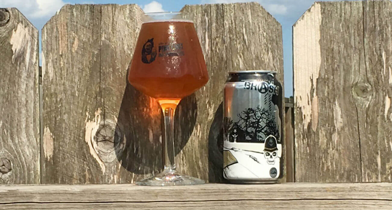 Beer-Chronicle-Houston-Craft-Beer-Review-Brash-EZ-7-Pale-Ale-Glass-Next-To-Can-On-Fence