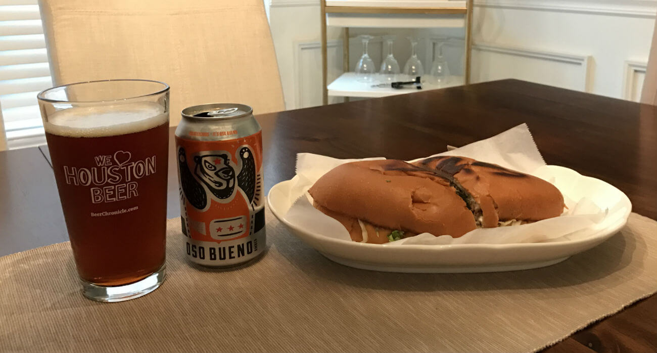 Beer-Chronicle-Houston-Craft-Beer-Review-Oso-Bueno-Beer-In-Pint-Glass-Next-To-Torta