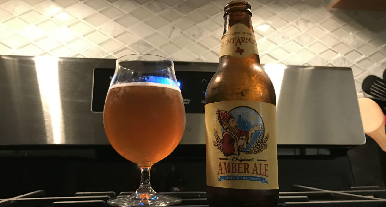 beer-chronicle-houston-craft-beer-review-saint-arnold-amber-ale-beer-in-glass-next-to-bottle-on-stove