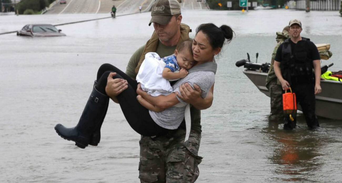 Beer-Chronicle-Houston-Craft-Beer-a-texas-sized-f-u-to-hurricane-harvey-man-rescuing-woman-and-child-from-flood